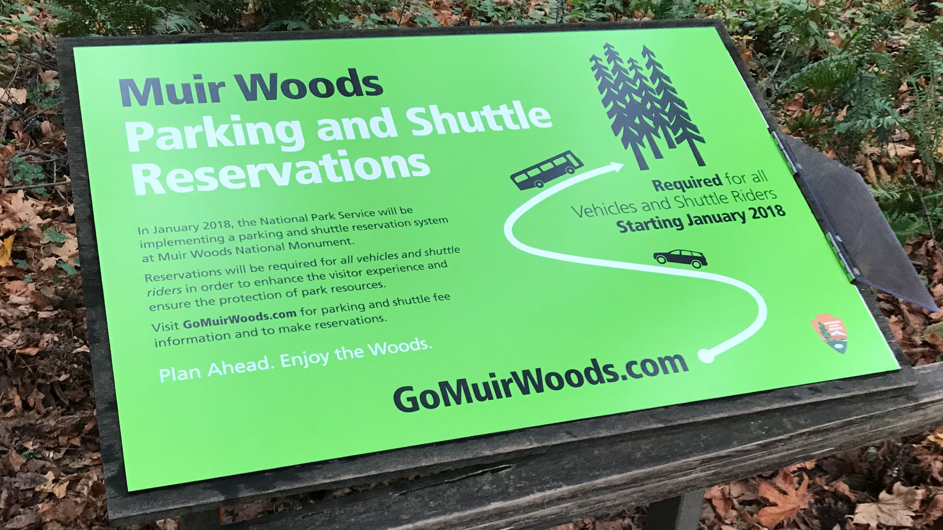 Sign panel providing information to park visitors about the parking and shuttle reservation system