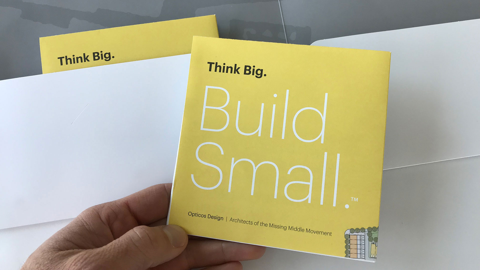 Cover of a brochure with headline: Think Big. Build Small.