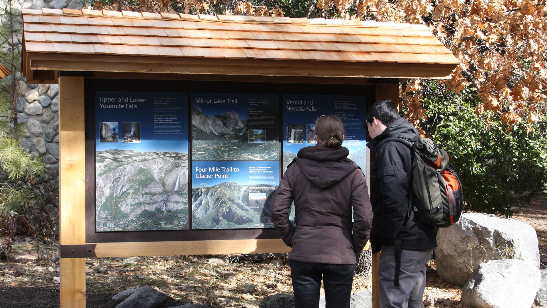 Interpretive signs on display in front of the Yosemite Valley Visitor Center